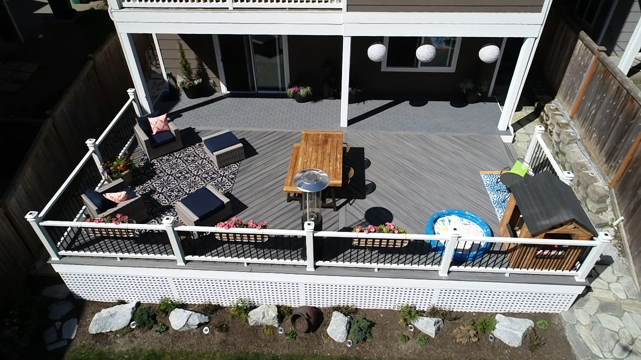 Custom-Decks-mixed-materials-decking-is-trex-island-mist-completed-white-fascia-and-trex-lattice-in-white-Azek-patio-bothell-washington