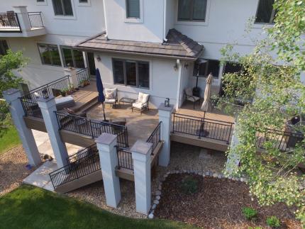 Custom-Decks-Timbertech-dark-roast-deck-two-levels-stucco-columns-custom-wrough-iron-railing-littleton-colorado