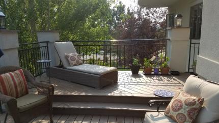 Custom-Decks-Timbertech-dark-roast-deck-two-levels-stucco-columns-custom-wrough-iron-railing-stamped-concrete-patio-littleton-colorado