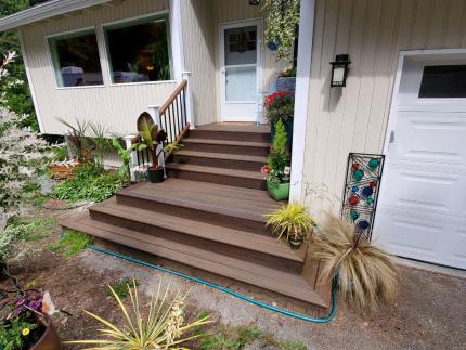 Custom-Decks-Trex-spiced-rum-transcend-railing-tree-house-white-posts-wrap-around-stairs-bothell-washington