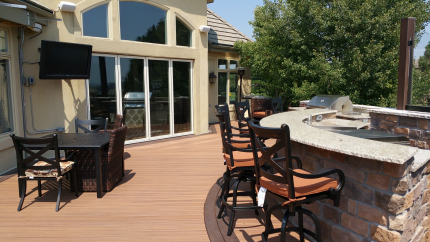 Custom-Decks-fire-pit-fire-place-etched-glass-bar-margarita-machine-two-outdoor-kitchens-two-tvs-Trex-decking-Havana-Gold-vintage-lantern-accent-Nana-wall-lone-tree-colorado
