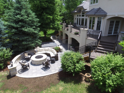 Custom-Decks-timbertech-english-walnut-decking-large-paver-patio-stone-bench-fire-pit-greenwood-village-colorado