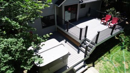 Custom-Decks-two-level-deck-trex-island-mist-decking-white-fascia-fortress-iron-railing-black-trex-posts-cedar-skirting-kenmore-washington