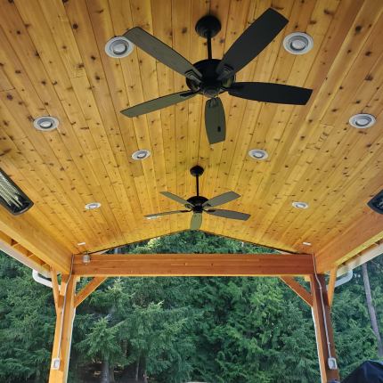 Custom-Decks-custom-gable-roof-patio-cover-6x6-support-posts-stained-glulam-beams-rustic-cross-braces-12-can-lights-3-heaters-Redmond-Washington
