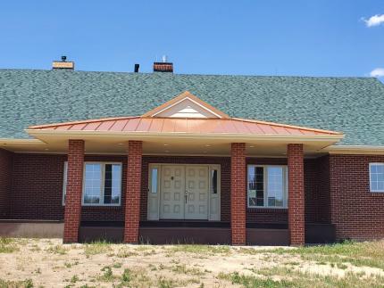 Custom-Decks-dutch-gable-patio-cover-copper-standing-seam-roof-green-shingles-Parker-Colorado-removed