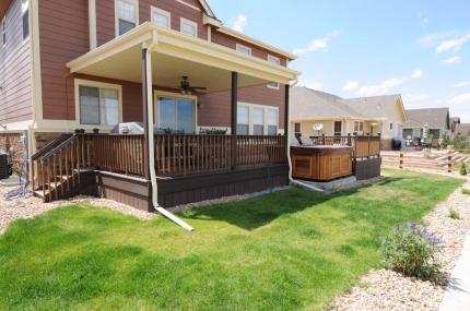 Custom-Decks-flat-patio-cover-white-soffit-one-fan-Centennial-Colorado