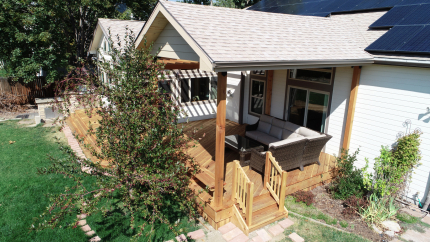 Custom-Decks-gable-roof-patio-cover-enclosed-front-shade-coverage-cedar-tongue-and-groove-underside-Golden-Colorado