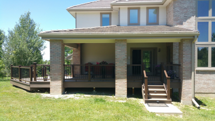 Custom-Decks-hip-roof-patio-cover-posts-wrapped-in-brick-can-lights-foxfield-colorado
