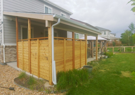 Custom-Decks-shed-style-patio-cover-standard-soffit-exposed-posts-privacy-wall-Aurora-Colorado