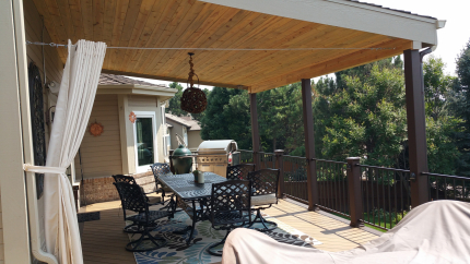 Custom-Decks-shed-style-roof-beetle-kill-tongue-and-groove-posts-wrapped-in-Trex-aurora-colorado
