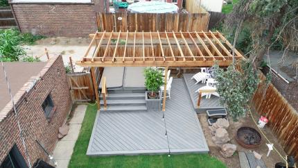 Custom-Decks-standard-wood-pergola-4x4-posts-2-2x8-beams-2x6-rafters-resting-on-top-Denver-Colorado