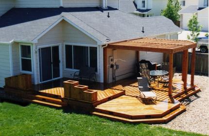 Custom-Decks-multi-level-deck-wrap-around-stairs-planters-pergola-redwood-aurora-colorado