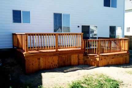 Custom-Decks-redwood-deck-solid-skirting-standard-snowpush-railing-Centennial-Colorado