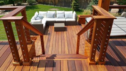 Custom-Decks-tigerwood-deck-planters-cable-rail-tigerwood-posts-top-cap-nana-wall-Greenwood-Village-Colorado